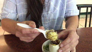 Eating Duck Embryo at Hong Kong Food Market