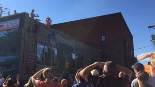 "Bacon Bash visitors try to catch stuffed pigs from the roof of Riverwalk Mercantile Sunday morning, Sept. 18, for the ""When Pigs Fly"" event that kicked off day two of the Bacon Bash."