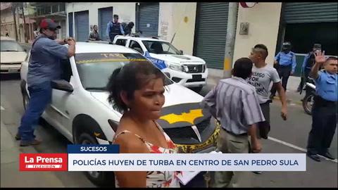 Policías huyen de turba en centro de San Pedro Sula