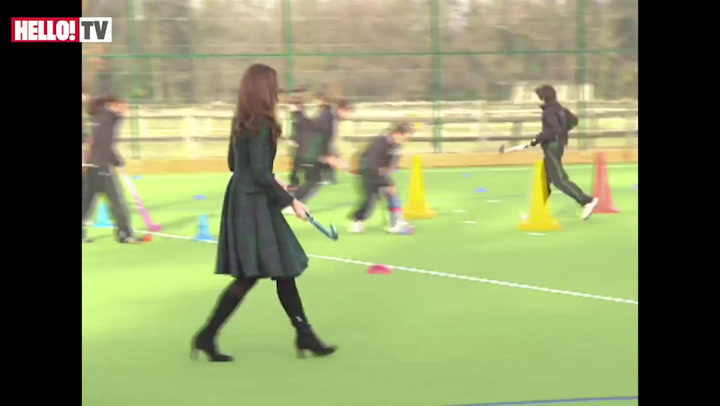 Kate plays hockey during visit to former school