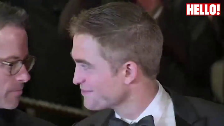 Robert Pattinson walks the Cannes red carpet