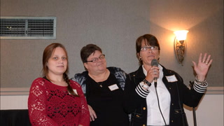 """Sandy Tersch, a self-acknowledged former addict, draws laughs from the audience and her fellow graduates Jill Zimmer, left, and Pamala Dale during their graduation ceremony Thursday at The Oaks at Eagle Creek in Willmar. The women are the first graduating class of the Willmar area Salvation Army's """"Getting Ahead Program."""""""