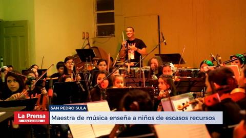 Maestra de música formada en EEUU enseña a niños de escasos recursos