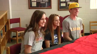 Trio signs for three different sports at Aurora