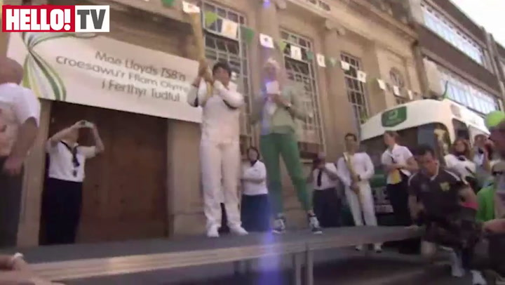Gethin Jones Receives The Olympic Flame in Merthyr Tydfil on Day 8 of The Olympic Torch Relay