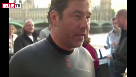 David Walliams celebrates the end of his 140-mile charity swim along the River Thames