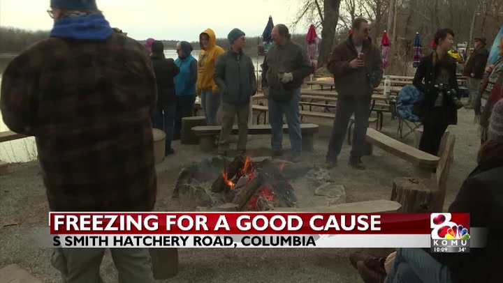People hop in the Muddy Mo for a good cause