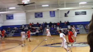 New Covenant's Brennan Williams dunks off a backboard pass