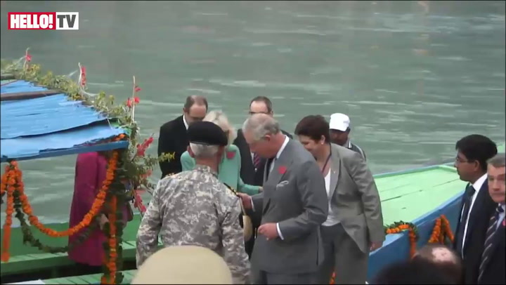 Prince Charles and Camilla take part in a traditional Aarti ceremony