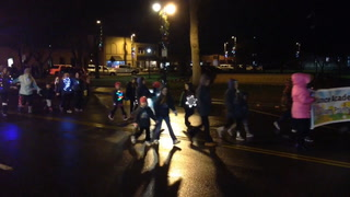 Children march down 10th Street on Tuesday evening during the Worthington Holiday Parade. (Tim Middagh/Daily Globe)