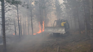 A T41 jet air tanker drops fire retardant on a blaze north of Staples Wednesday afternoon. Fire fighters from the Minnesota Department of Natural Resources, Staples and Verndale battled the 100 acre fire which burned quickly in a pine plantation near Oylen. Forum News Service | Steve Kohls