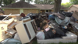 Mountains of Debris Linger in Houston After Harvey