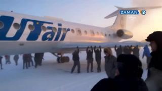 Yolcular uçağı iterek çalıştırdı