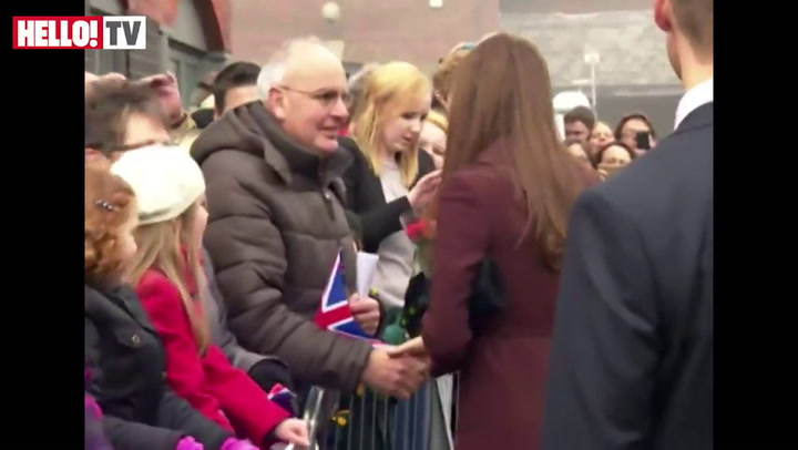 Pregnant Kate receives congratulations from the Grimsby crowd