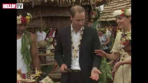 Prince William cuts coconut in half with machete during visit to Tuvalu