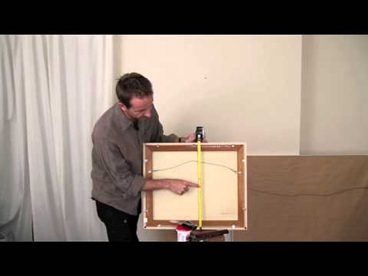 how to hang your artwork and not screw it up | apartment therapy
