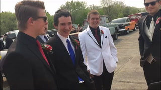 A Lotus provides a stylish ride to Grand March.