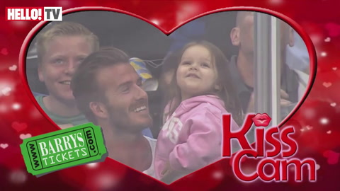David Beckham gives daughter Harper a sweet kiss for the Kiss-Cam