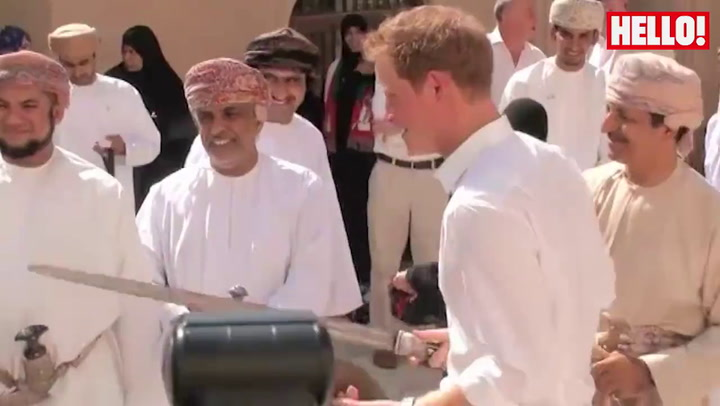Prince Harry giggles his way through mock swordfight