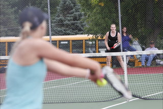 Brooke Kern / Sun  Tribune Morgan Rohloff returns a serve with a backhand during the match against Minnewaska on Tuesday, Sept. 6 in Morris. Rohloff and doubles partner Hannah Wutzke dropped the No. 2 doubles point in straight sets to the Lakers.