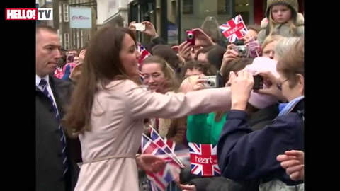 William and Kate receive baby gifts during walkabout in Cambridge