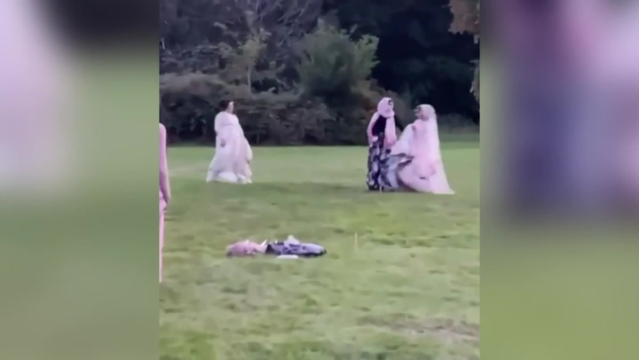 Bride scores home run playing rounders in 24kg Pakistani wedding dress