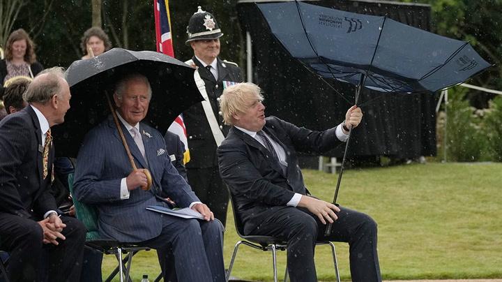 Boris Johnson struggles with umbrella as Prince Charles laughs beside him