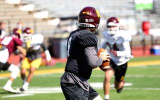 UMD senior quarterback John Larson drops back to pass during a drill at Malosky Stadium during practice on Tuesday, Sept. 21, 2021. Dan Williamson / Duluth News Tribune