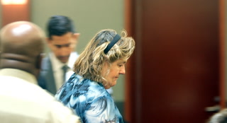 Woman accused of stealing $1M from company makes court appearance