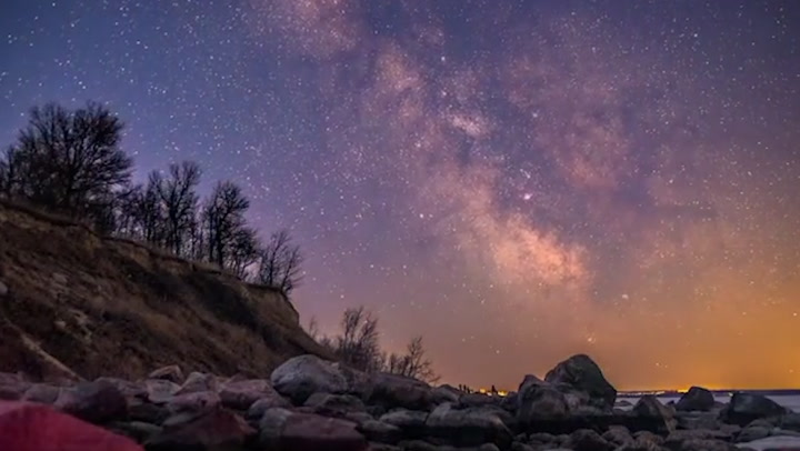 Night sky pops with color in time-lapse video over Canada