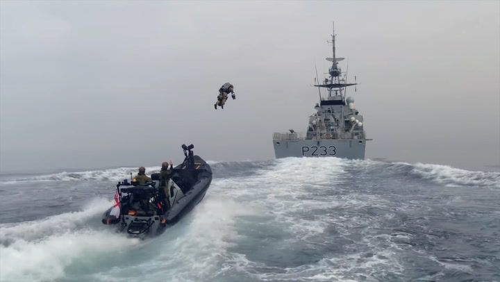 Royal Marines use jet pack to board ship at high speed