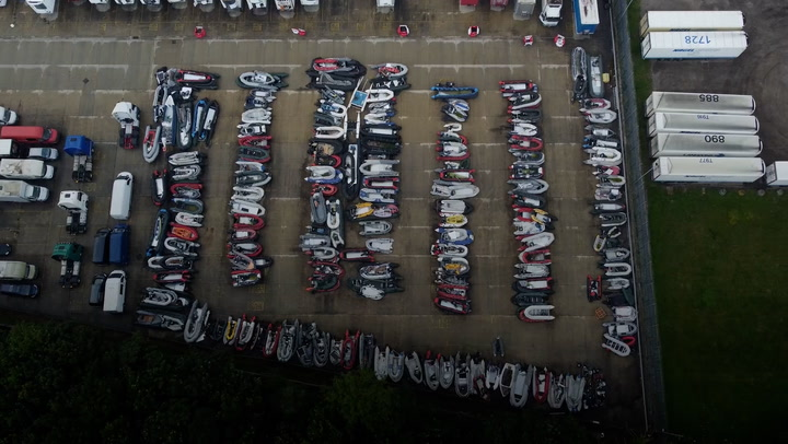 Drone footage shows dozens of migrant dinghies stacked up in Dover