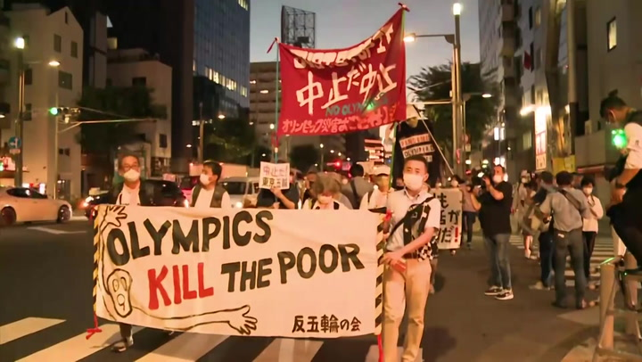 Olympics: Dozens march Tokyo streets in protest of the Games