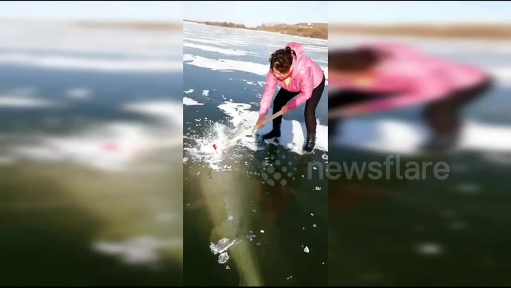 Women Do What It Takes To Dislodge A 220-Pound Fish Trapped In A Frozen Lake