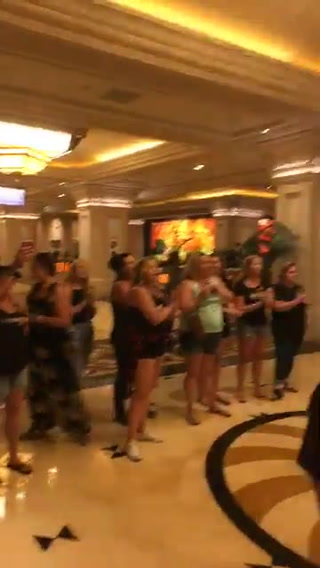 Protestors gather in Mandalay Bay lobby on Oct. 1, 2018