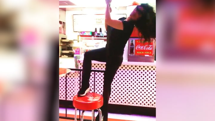Salma Hayek pole-dances in the middle of a restaurant and shows off her fabulous physique