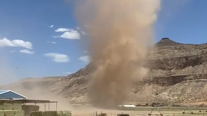 Dust devil towers over Utah farm amid dry heat