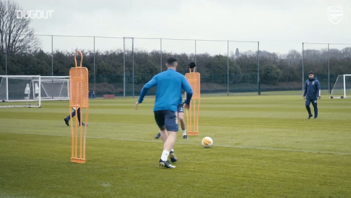 Behind the scenes: Arsenal stars take on shooting drills in training.