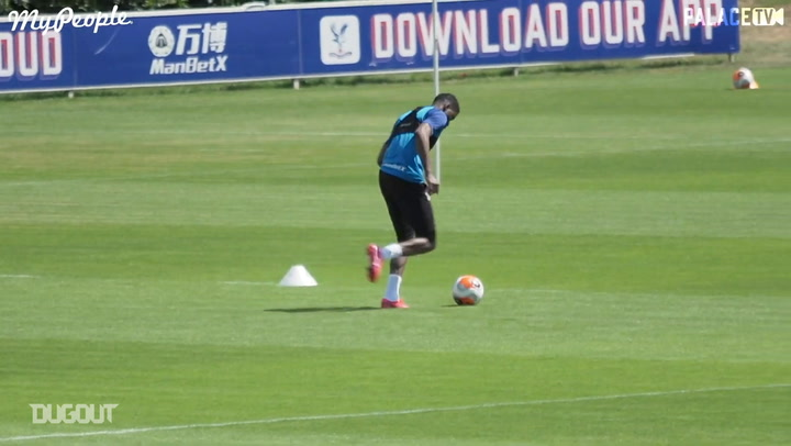 Wilfried Zaha practises dribbling in non-contact training