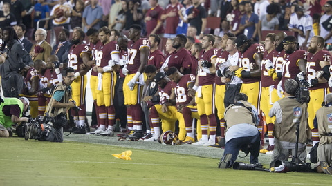 NFL Considers Penalty  for Anthem Kneeling
