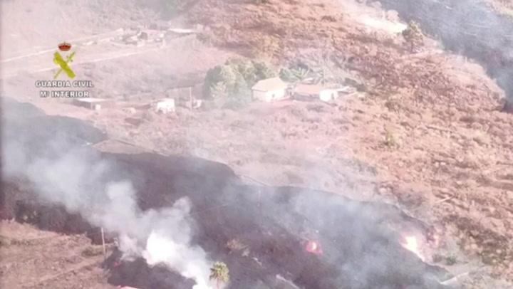 Spanish Civil Guard flies over erupting volcano