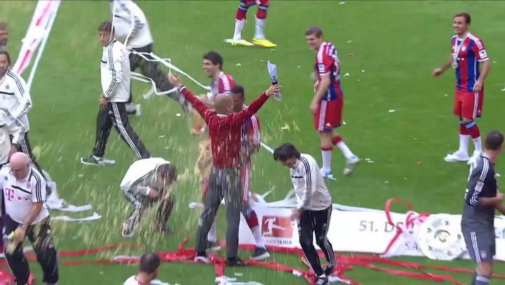 Müller y Guardiola, durante la celebración del título en 2014