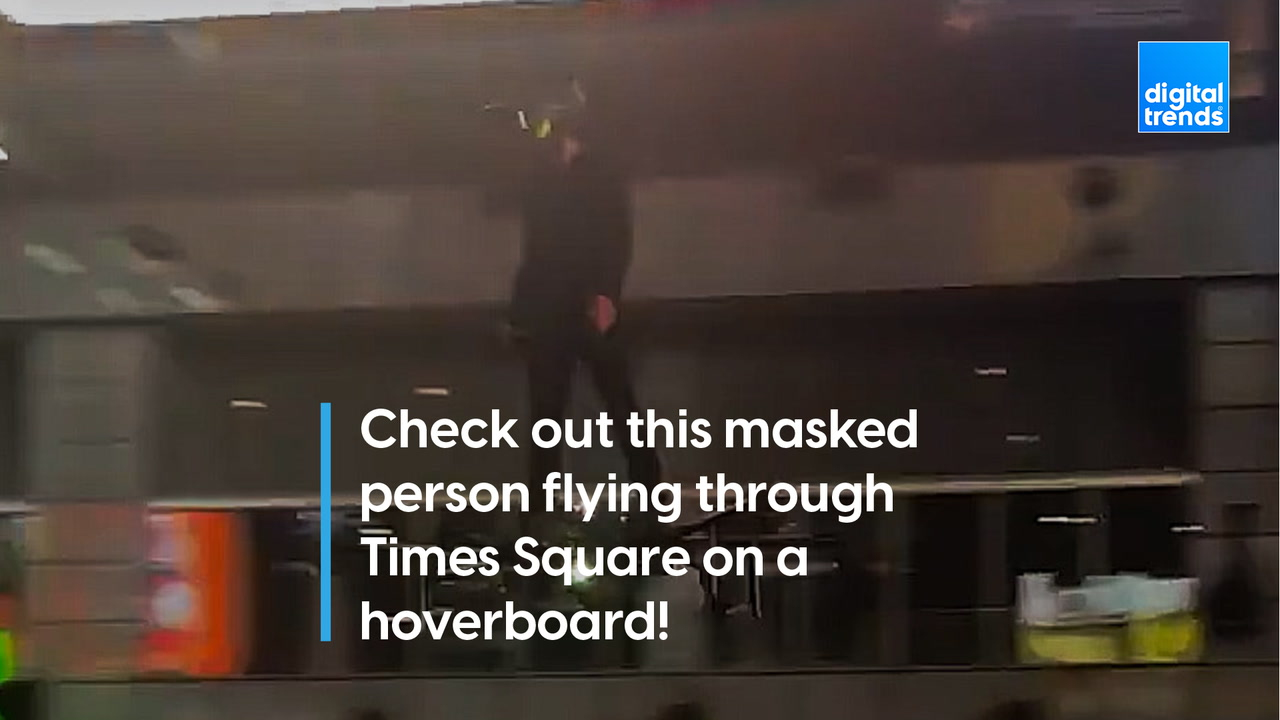 Spectators surprised by man flying through Times Square on a hoverboard