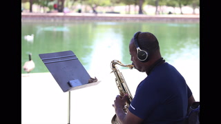 A local hospital nurse plays his saxophone during his day off