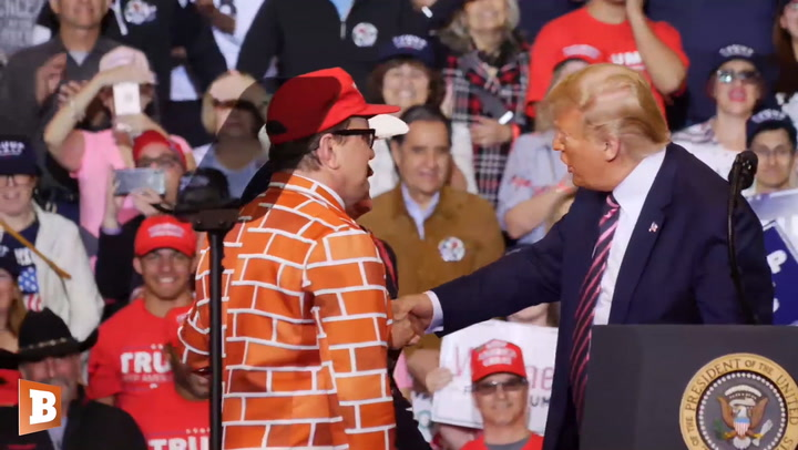 Trump Features Supporters Wearing Wall Suit and 'CNN Fake News' Shirt