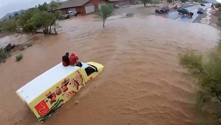 Dramatic moment helicopter rescues two men stranded on lorry roof in Arizona floods