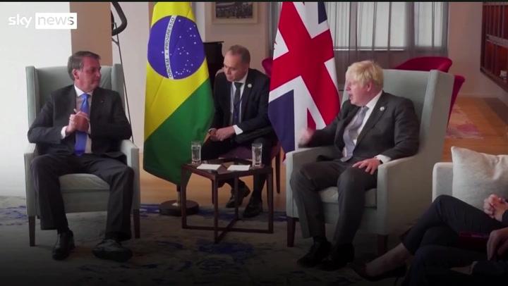 Boris Johnson tells Brazil's anti-vax president to get jabbed in awkward exchange