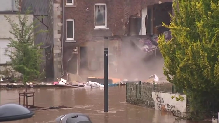 Flooded house collapses during TV interview with Belgian mayor