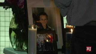 Vigil for 6-year-old held at Centennial Park