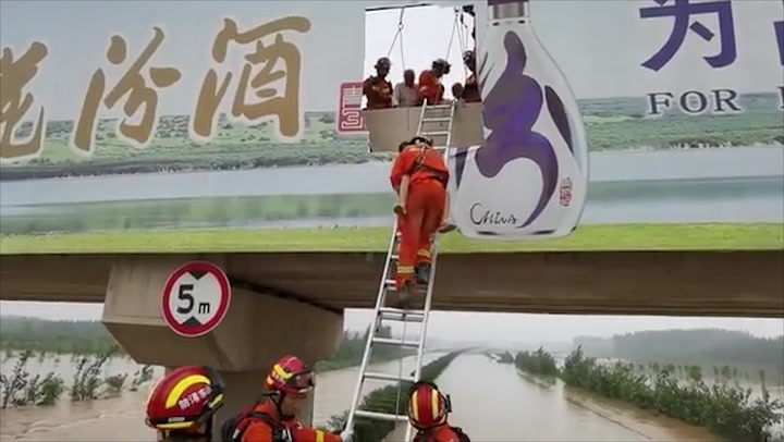 Firefighters rescue hundreds stranded on bridge amid extreme flooding in China